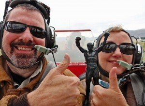 Larissa and Michael in open biplane with little rocky