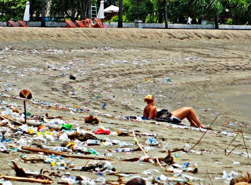 trash on beach in bali