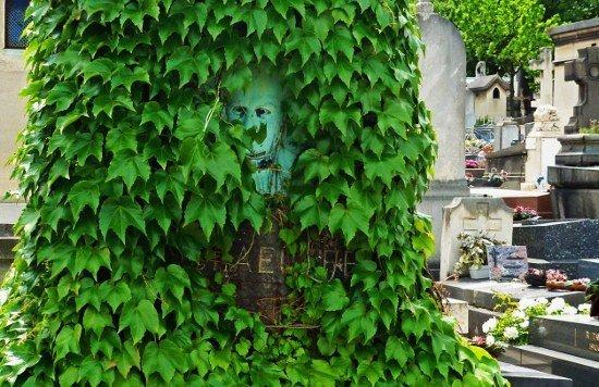 Montparnasse Cemetery Man peering behind ivy