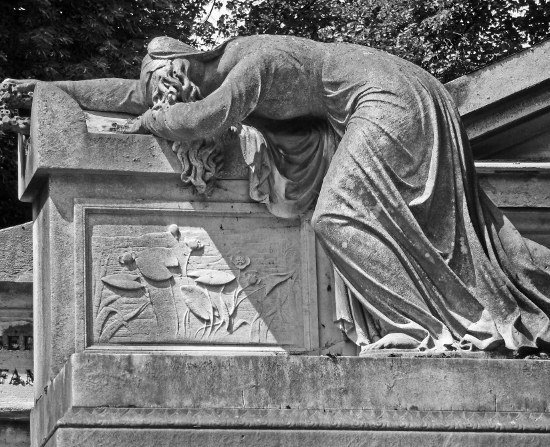 Pere Lachaise cemetery woman weeping on tomb