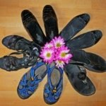 women's travel shoes laid out in a circle with flowers