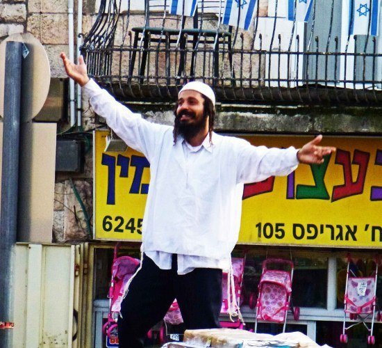 Machane Yehuda market Jerusalem man dancing