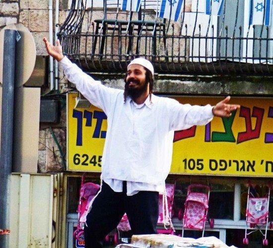 Machane Yehuda market Jerusalem man dancing