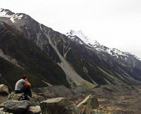 New Zealand Road trip man overlooking glacier