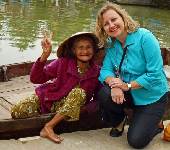 Larissa and woman on boat Hoi An