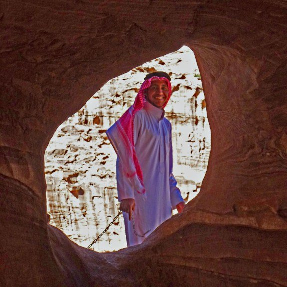 Petra Bedouin through hole in cave