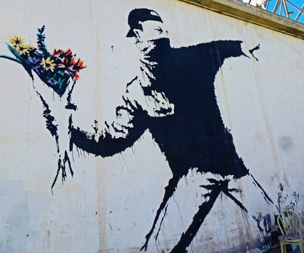Israeli security defense wall murals Banksy