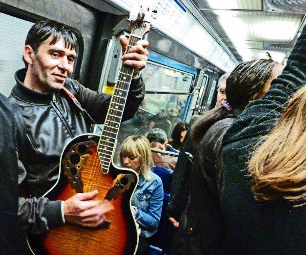 Street musicans Paris Metro guitar player