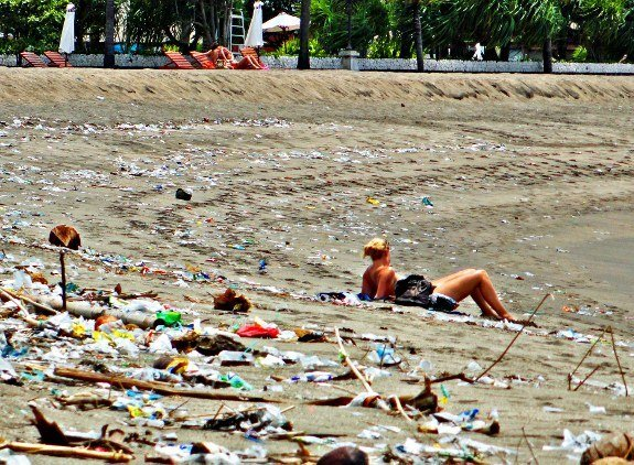 Bali Kuta Beach trash with girl