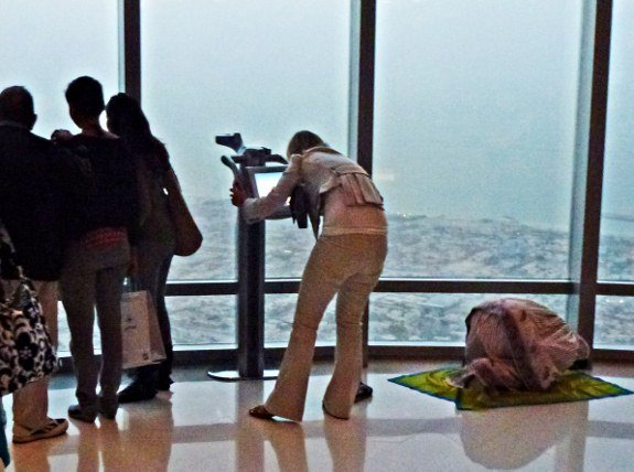 Burj Khalifa Dubai woman praying