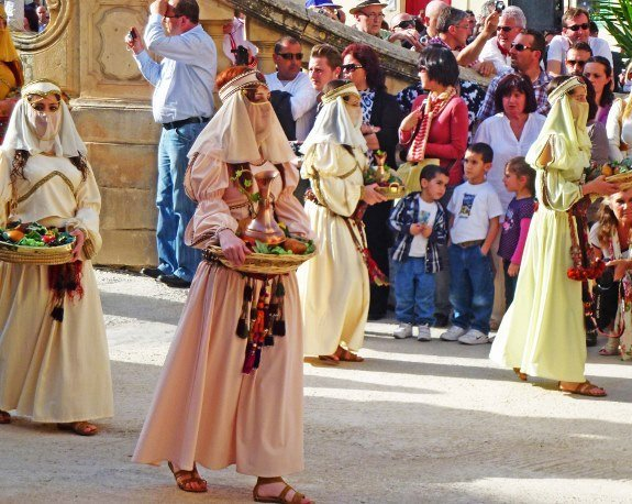 Malta good friday parade women with trays (575x458)