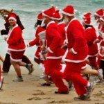 New Zealand santas running on beach