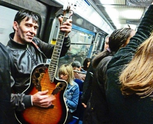 Street musicians of Paris guitar player metro