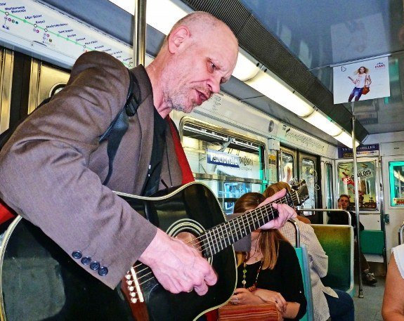 Street musicians of Paris guitar player metro Dylan