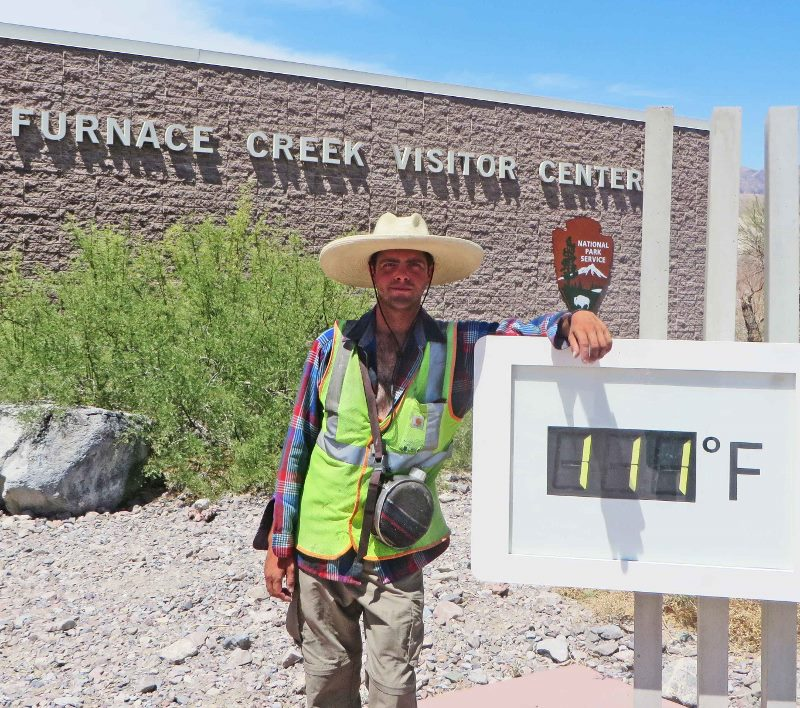 Stafford at Furnace Creek VC in Death Valley, with thermometer 111 degrees!