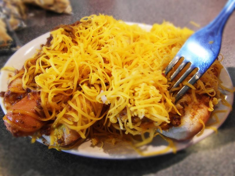 Cincinnati coneys-hot dogs with chili and cheese on top