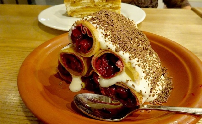 Clatite-Romanian pancake dessert filled with cherries