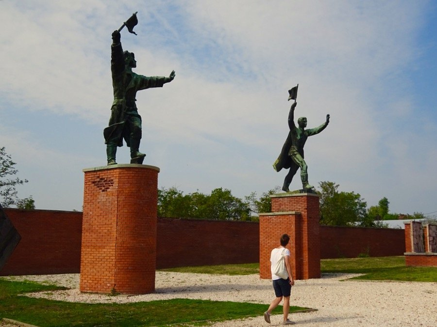 Budapest memento Park 2 boys with flags