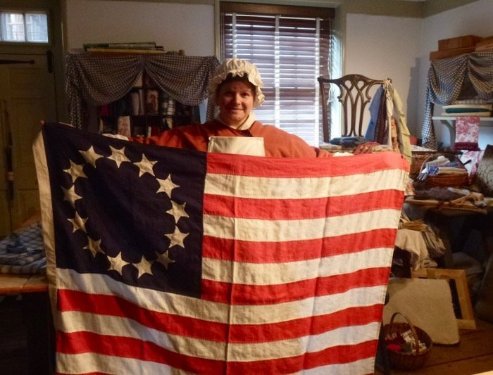 Betsy Ross house woman holding first flag