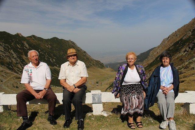People sitting on guardrail on Transfagarasan Highway