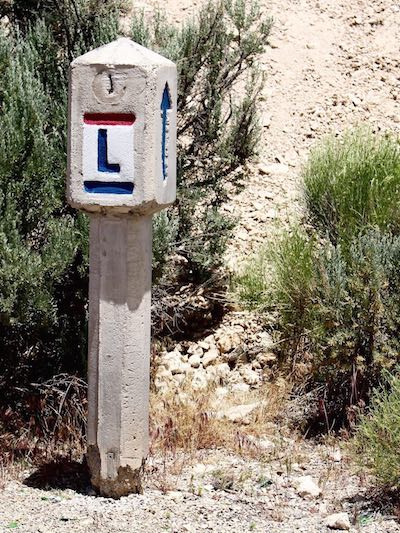 Stone markers indicating a portion of the historic Lincoln Highway that shares the Loneliest Road in Nevada were installed by the Boy Scouts in 1928 to aid motorists and commemorate America's first transcontinental route.