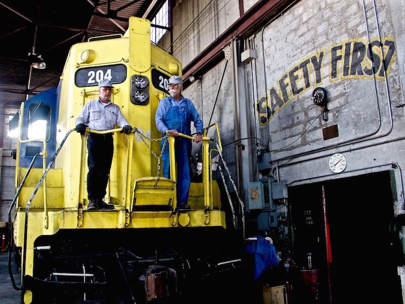"Two ""campers"" who spend their vacation tinkering with trains at the Nevada Railroad Museum in Ely, Nevada along the state's Loneliest Road"
