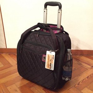 Perfect travel tote with wheels: Delsey quilted rolling tote