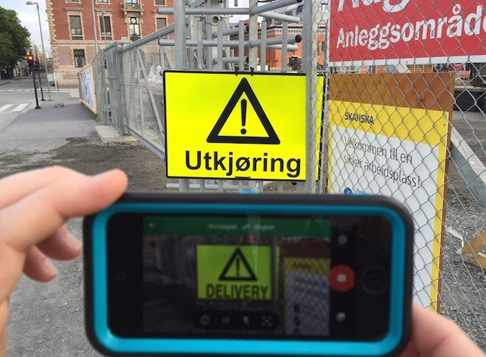 Translating a sign in Oslo with the Google Translate tool. Photo by Larissa Milne