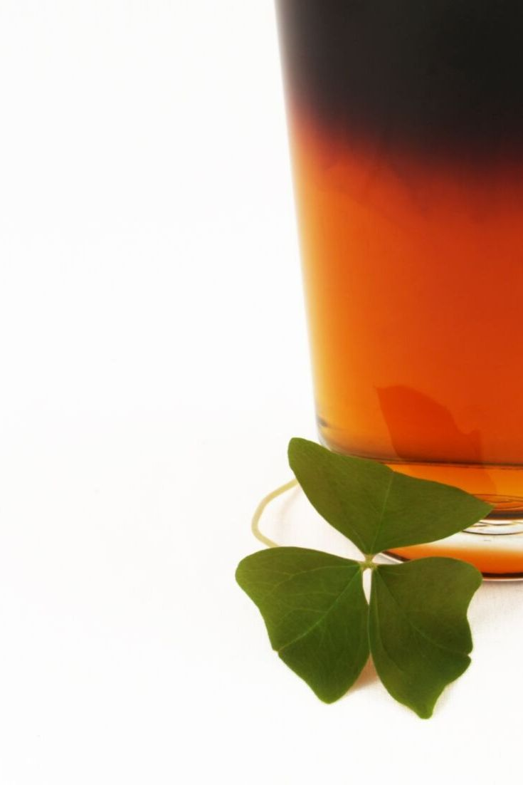 Black and tan beer with shamrock