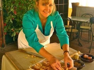 Larissa taking a pasta making class in Italy