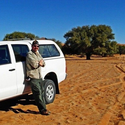 Michael with truck at Sossusvlei red dunes in Namibia