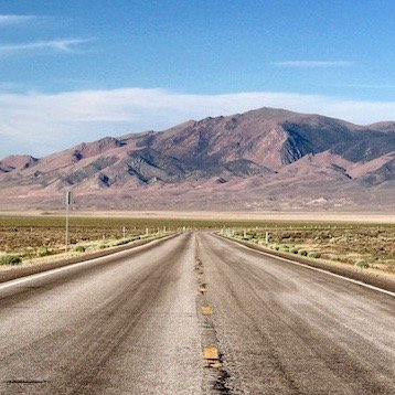 Loneliest Road-Nevada-open road with mountains