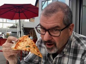 Michael eating pizza