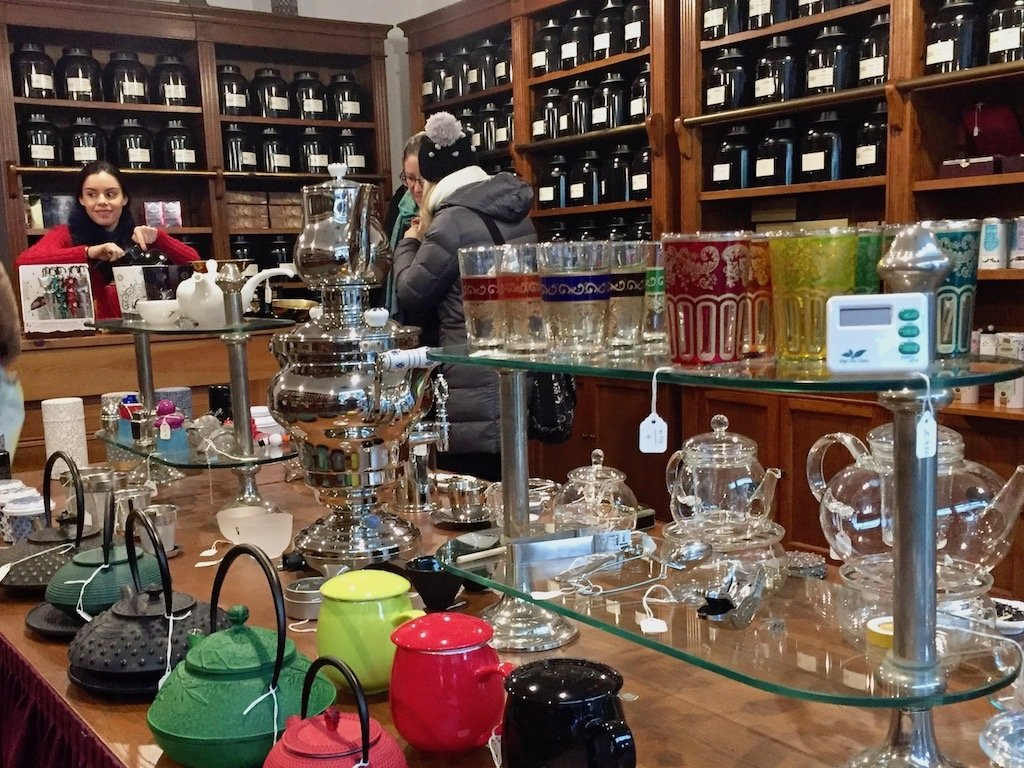 interior of London Tea Exchange, teapots on display, cannisters of tea on shelves