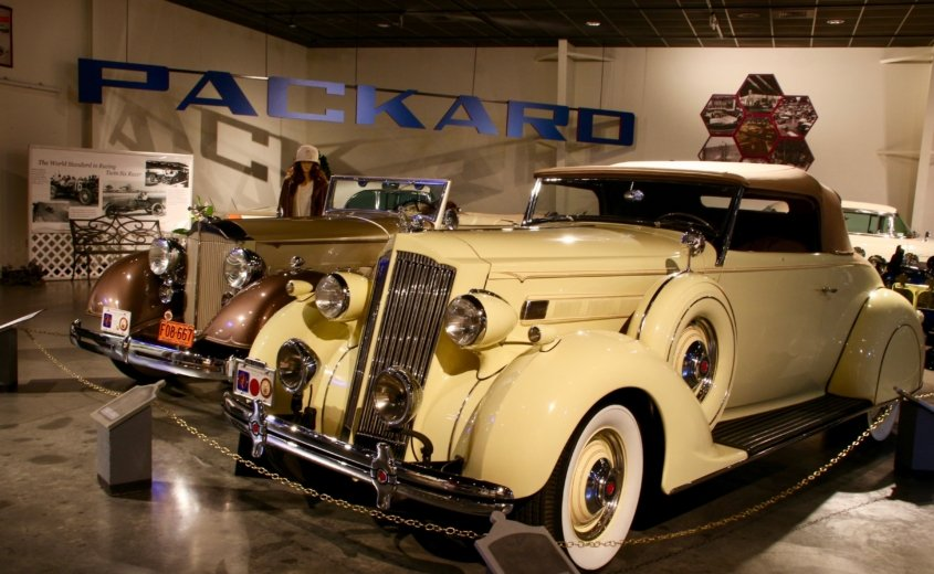 two vintage Packard automobiles