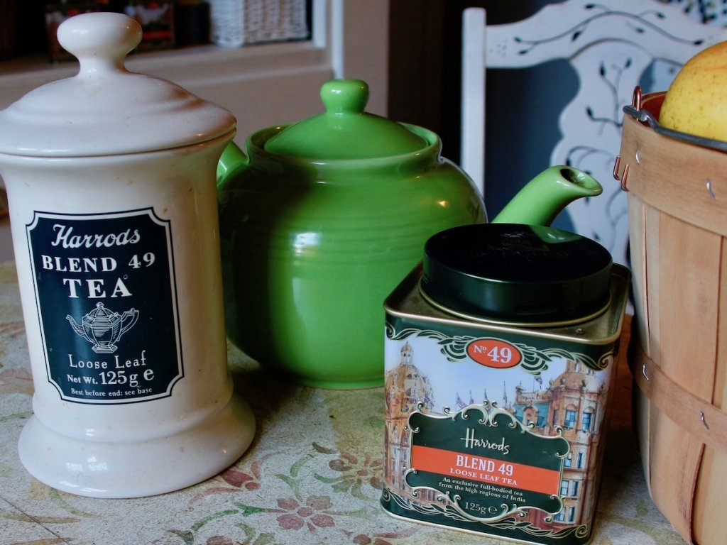 Canisters of Harrods tea with green tea pot-horizontal image