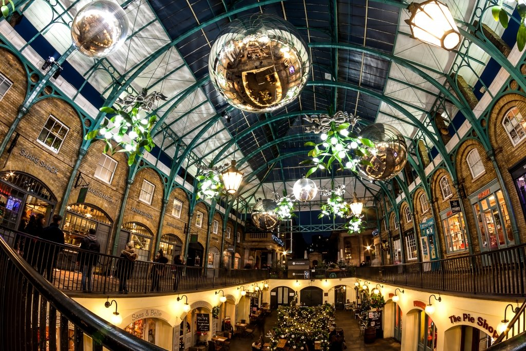 Glass-covered market hall with large Christmas balls suspended