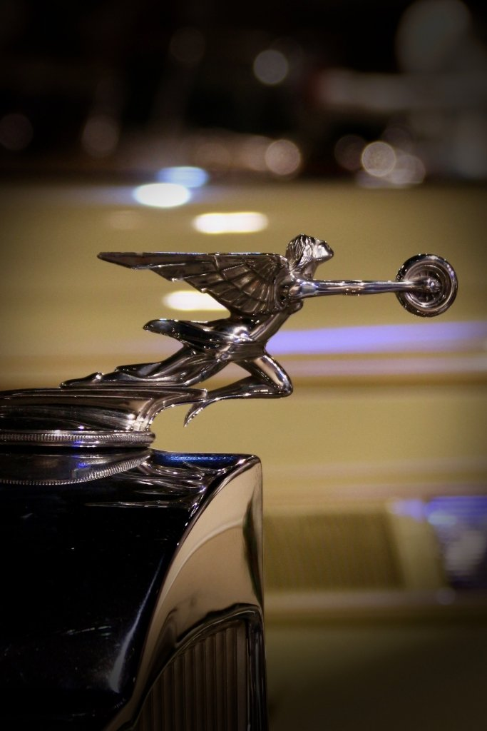 Packard hood ornament-winged figure holding wheel