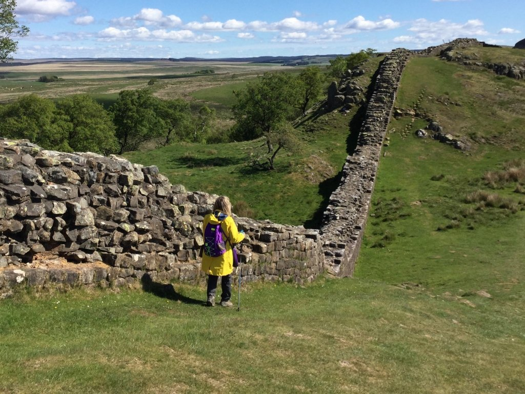 Larissa hiking next to Hadrian's Wall